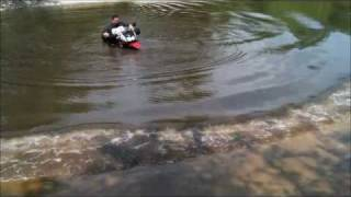 KAWASAKI KLR 650 RIDING THROUGH A  DEEP RIVER WITH SNORKEL