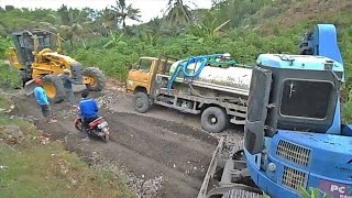 Dump and water tank Truck Stuck Recovery with Grader GD555 and mini Excavator 78uu