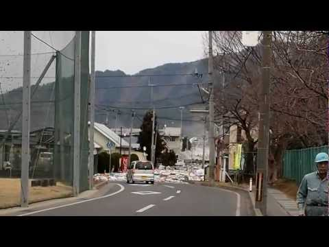 2011 Japan Tsunami: the water pouring over the seawall in Miyako [Stabilized]