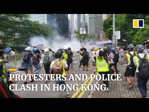 Demonstrators and police clash during Hong Kong anti-extradition protests