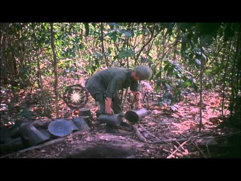 US 1st infantry division soldiers dig Viet Cong munitions out of tunnels in South...HD Stock Footage