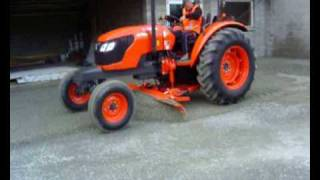 Neilo Kubota M7040 Tractor Grader in operation in restricted space