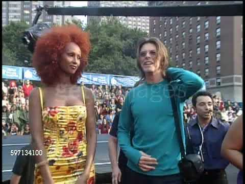 Download (1999) David Bowie and Iman arriving Video Music Awards