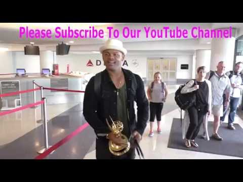Anthony Hemingway talks about his Emmy for American Crime Story while carrying his Emmy while depart