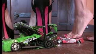 Miss Iris crushing toy cars under her sexy heels
