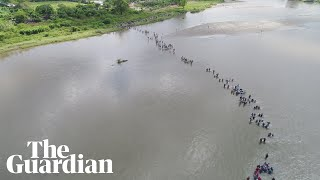 Caravan of migrants crosses river from Guatemala to Mexico