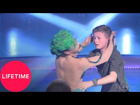 Abby's Ultimate Dance Competition: Full Dance:Medusa's Tragic Romance   Lifetime: Watch Travis and Trinity's full duet dance, Medusa's Tragic Romance, from Abby's Ultimate Dance Competition Season 2 Episode 3 (Gods and Mortals).  Check out Abby's Ultimate Dance Competition for more videos and extras! http://www.mylifetime.com/shows/abbys-ultimate-dance-competition http://www.facebook.com/lifetime http://twitter.com/lifetimetv  Lifetime® is a premier female-focused entertainment destination dedicated to providing viewers with a diverse selection of critically acclaimed and award-winning original movies, scripted dramas, and unscripted programming. A favorite and trusted network for women, we are continually building on our heritage by attracting top Hollywood talent and producing shows that are modern, sexy, exciting, daring, and provocative. Visit us at myLifetime.com for more info.  Lifetime® is a premier female-focused entertainment destination dedicated to providing viewers with a diverse selection of critically acclaimed and award-winning original movies, scripted dramas, and unscripted programming. A favorite and trusted network for women, we are continually building on our heritage by attracting top Hollywood talent and producing shows that are modern, sexy, exciting, daring, and provocative. Visit us at myLifetime.com for more info.