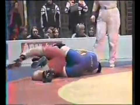 Pin usin leg scissors in female freestyle wrestling match