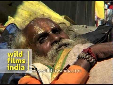 Sadhu sleeps on the ground at Chandanwari base camp
