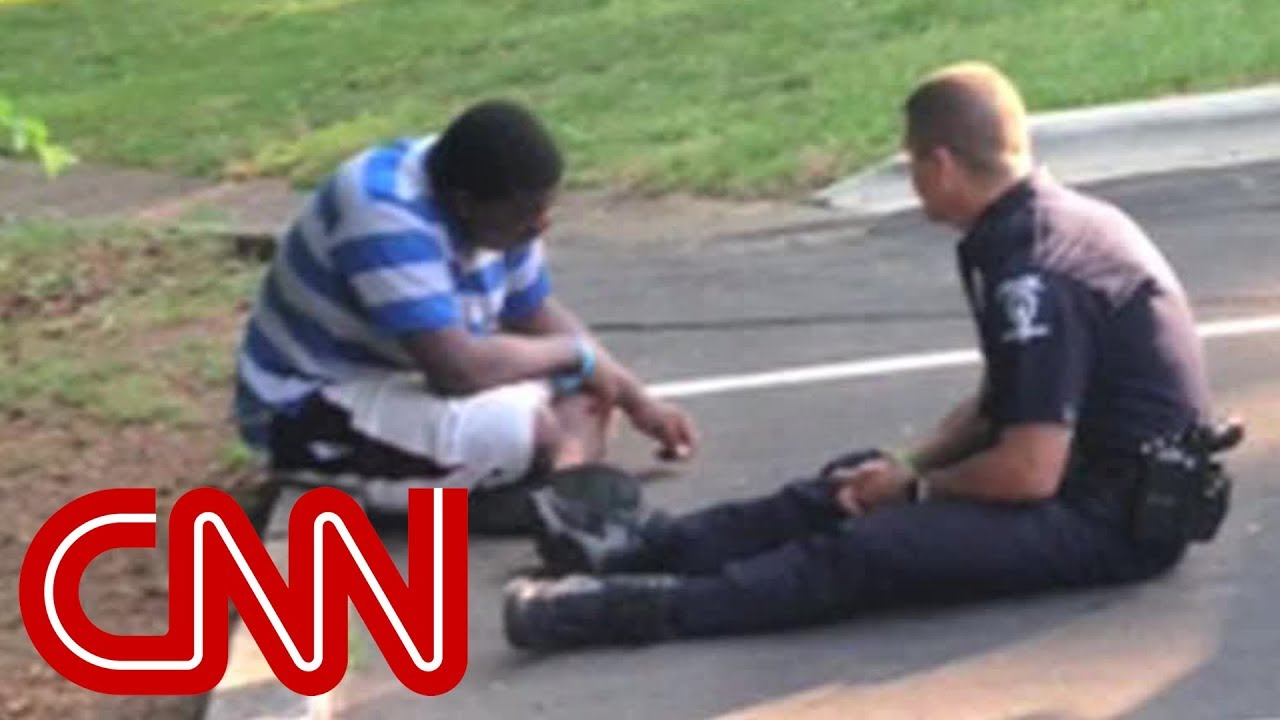 A photo of police officer consoling a teenager goes viral.