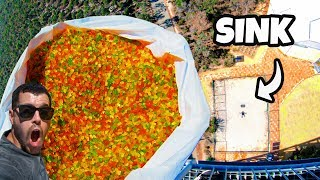 CATCHING 200,000 GUMMY BEARS from 45m Tower! WILL IT CLOG?