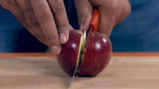 Cutting an apple in half in slow motion