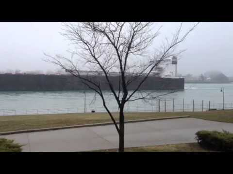 1000 foot Great Lakes freighter heading into a foggy Lake H