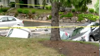 Nearly 300 residents evacuated after cars fall in sinkhole
