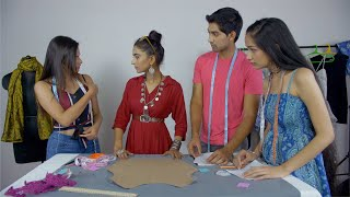 Students in casual wear attending their fashion studies lecture at the college