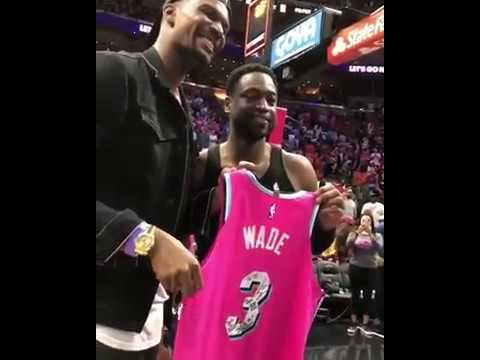 8d22e850d6e5 Dwyane Wade signs his Miami Vice jersey and gives it to Chris Bosh ...
