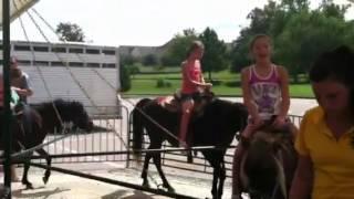 Emma and Bella riding ponies