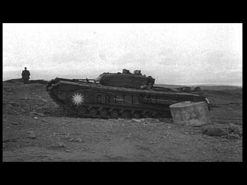 6 pounder anti tank gun is fired to remove the beach obstacles in Great Britain d...HD Stock Footage