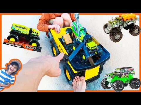 MONSTER TRUCKS Racing in a DUMP TRUCK!?!