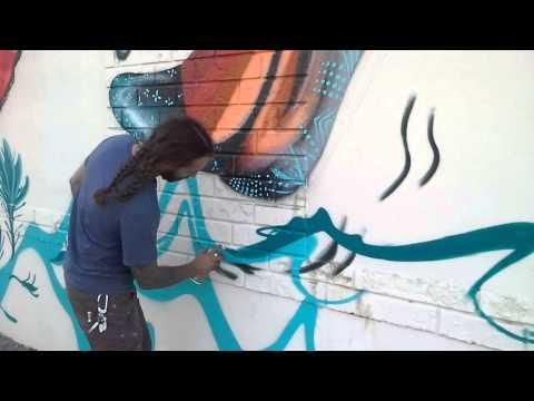 Ernesto Maranje painting murals in Hialeah Florida