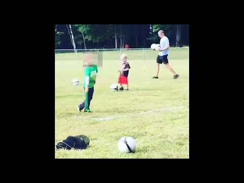 Little Boy Is Determined to Kick Soccer Ball