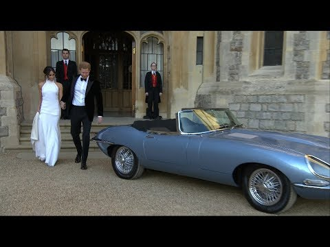 Newlyweds Prince Harry and Meghan Markle drive to evening re