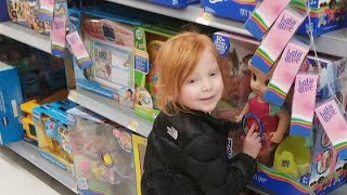aly shopping in the walmart toy isle