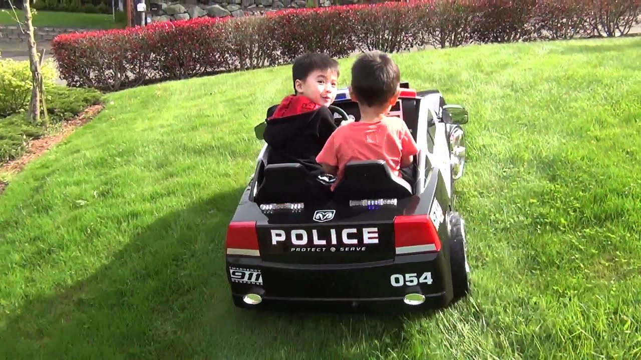 The Boys Patrolling The Yard In Their Ride-on Dodge