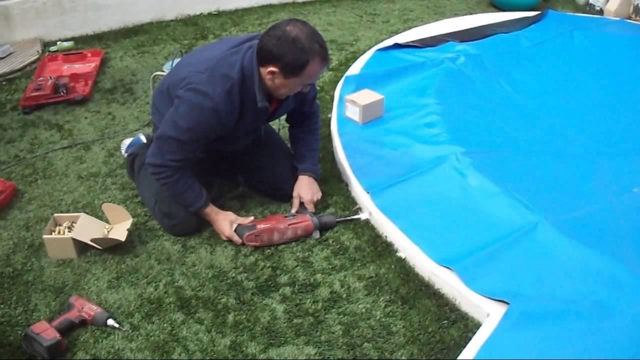 Instalacion lona para piscina youtube for Enganches para toldos