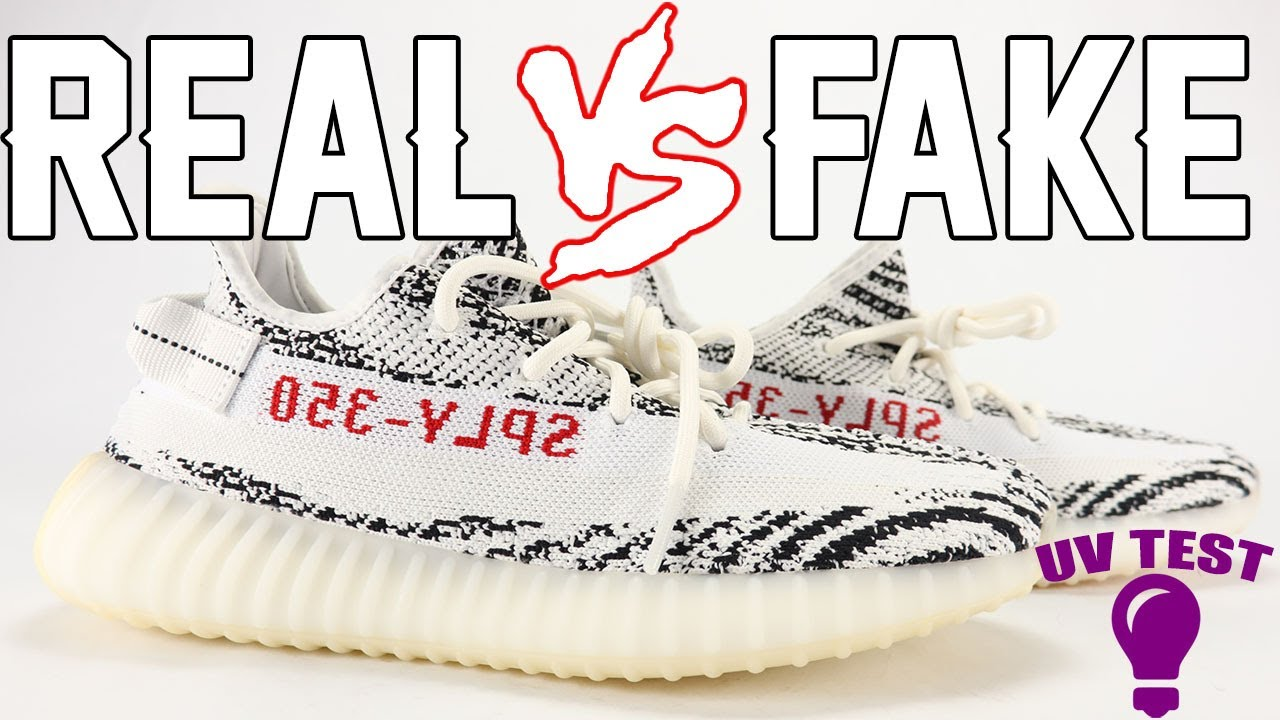 cd85914b417 Real vs Fake adidas YEEZY Boost 350 V2 ZEBRA Legit Check UV Light ...