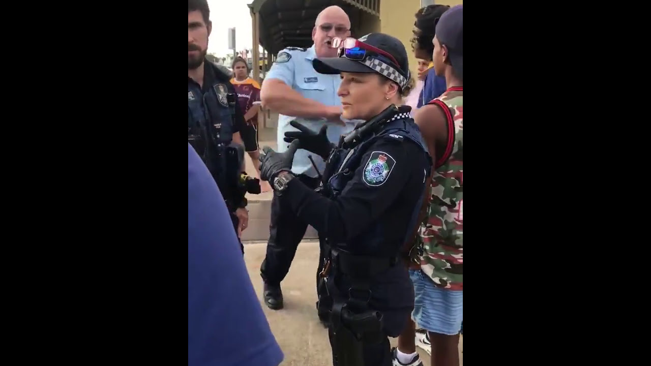 Bogan white cop attacks two Aboriginal females, one woman and one teen.