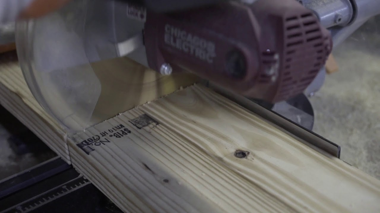 Saw cutting 2 pieces of wood Free Stock Footage