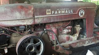 Grinding hog feed with the Farmall M and the New Holland 351