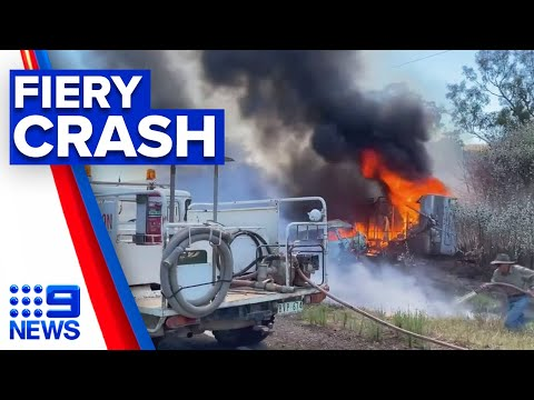 Driver hands himself in after fiery caravan roll | 9 News Australia