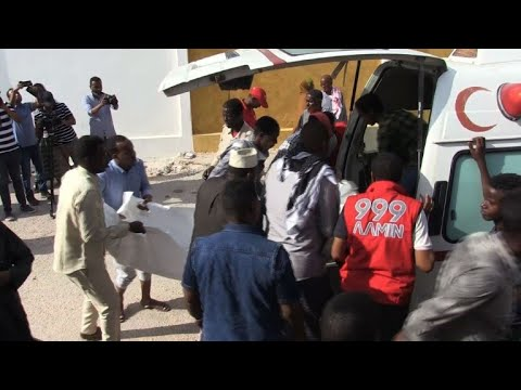 Relatives retrieve bodies after car bombs in Somali capital