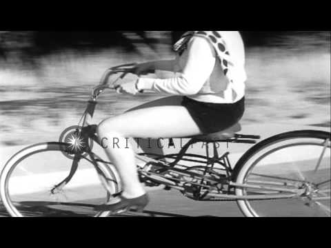 Young women ride bouncing bicycles aka 'Rhythm Bicycles' created by Joeseph Bell. HD Stock Footage
