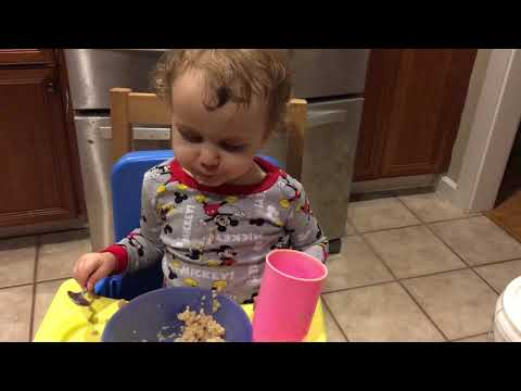 Sleep eating oatmeal and a cup of milk