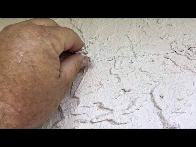 Fix a stucco crack repair and exterior painting of a home in Port St John Florida