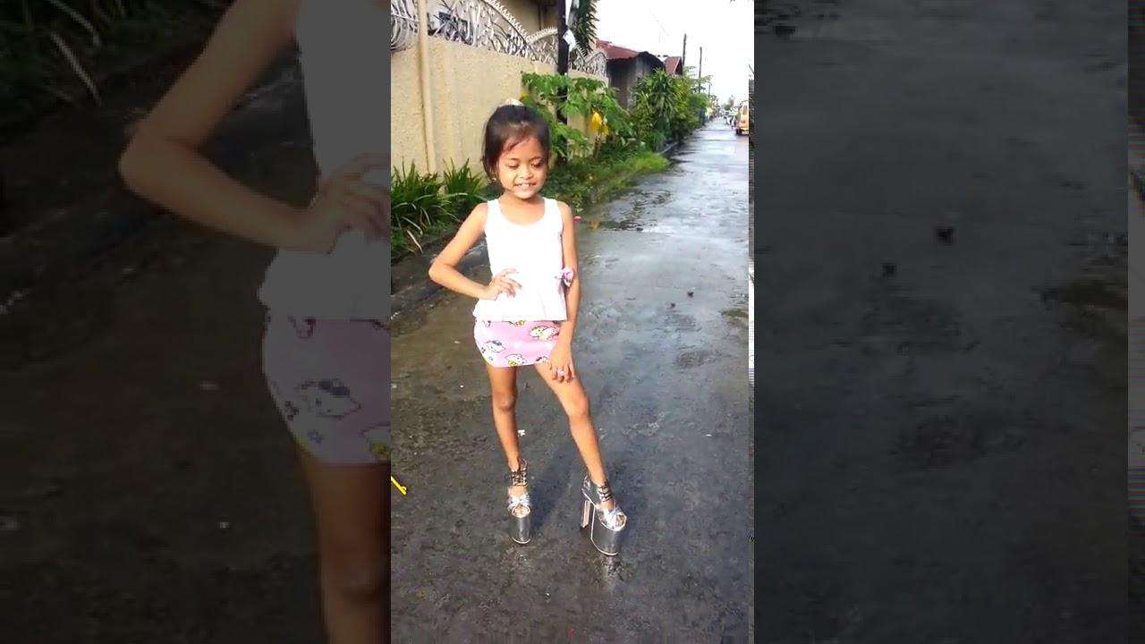 Little Girl Walking in High Heels - Stan Twitter