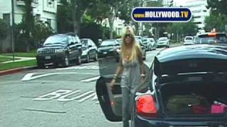 Shauna Sand picking up her daughters at school