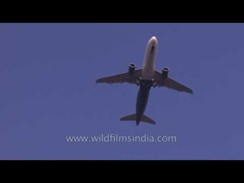 Wheels down! Planes prepare to land at Delhi airport...