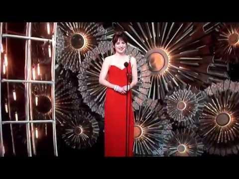 Dakota Johnson presenting Maroon 5 at the Oscars 2015