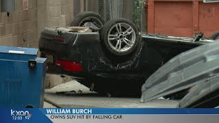 Woman drives BMW off parking garage, strikes SUV below