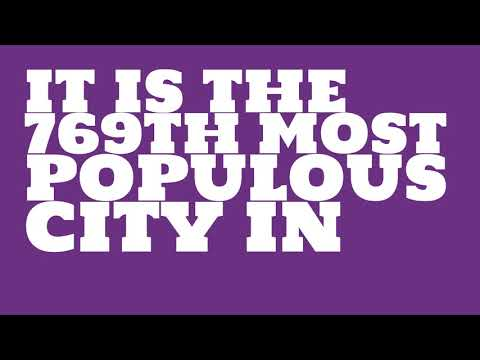 How does the population of Grand Island, NE compare to Manhattan?
