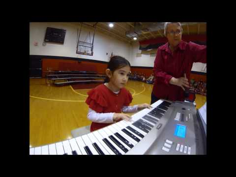 7 year old girl plays christmas songs on Piano, MUST SEE!!!