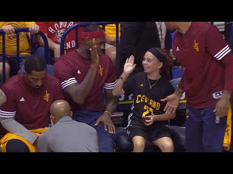 Little girl's priceless reaction after sitting with LeBron on bench