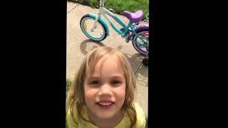 Ride Teagan Ride!!! Teagan rides her bike with training wheels. May 2016