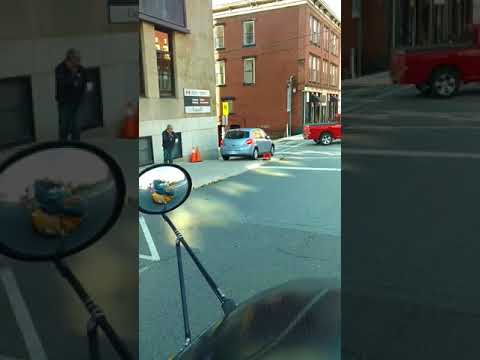 Car runs School bus stop by driving on the sidwalk