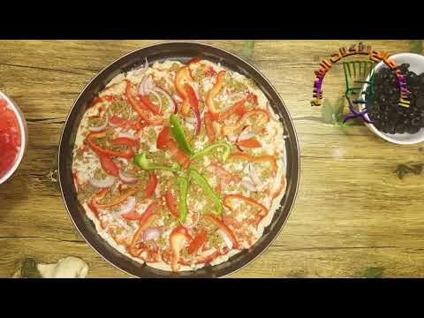 صورة  طريقة عمل البيتزا طريقة عمل البيتزا بٲسهل الطرق والطعم روعه طريقة عمل البيتزا من يوتيوب