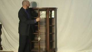 Curved Oak Curio Cabinet With Mirror
